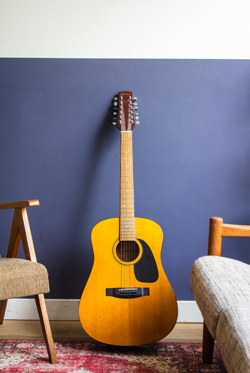 Guitar leaning against wall